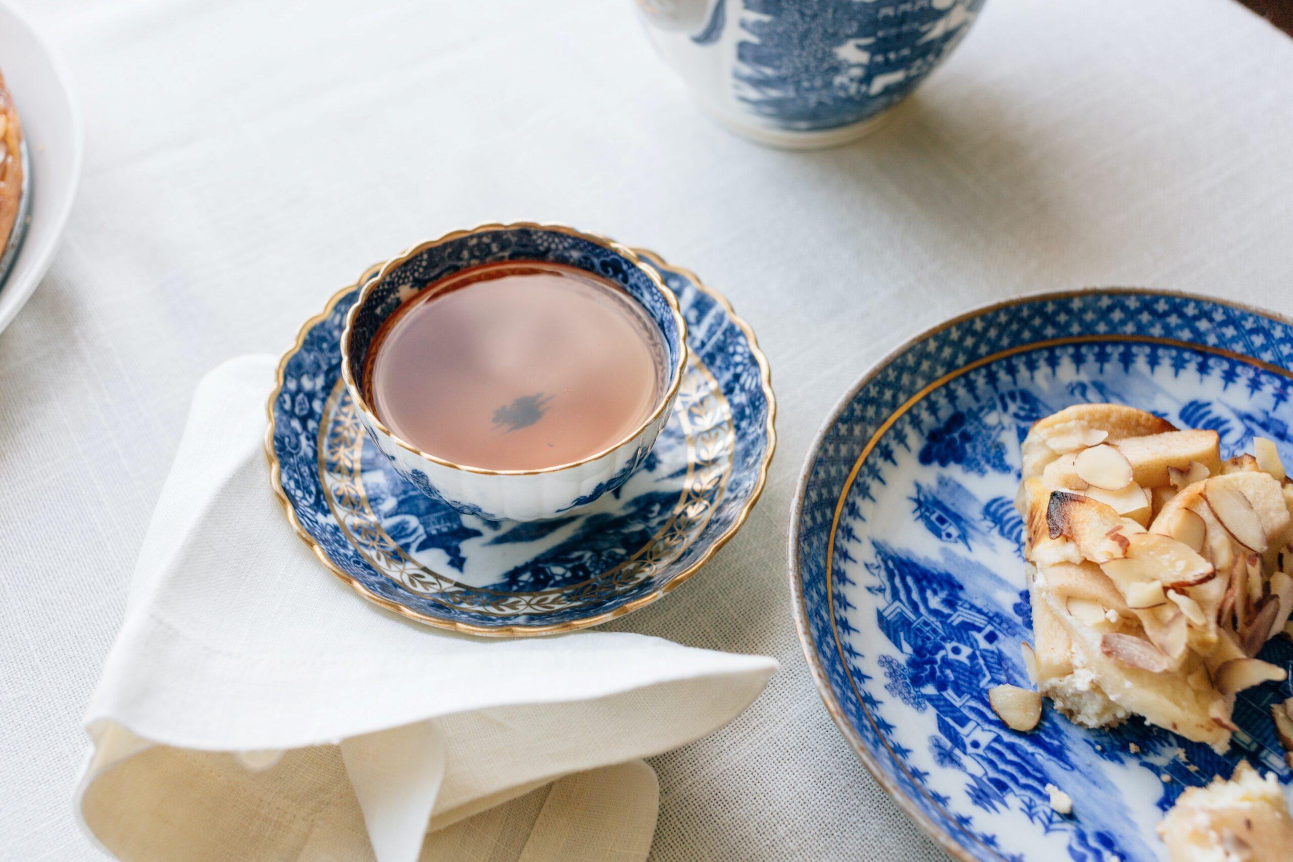 A porcelain tea cup with a black tea on a table