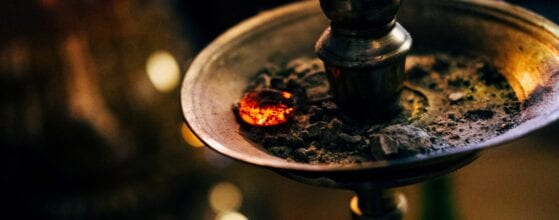 An old-fashioned shisha with burning shisha coals